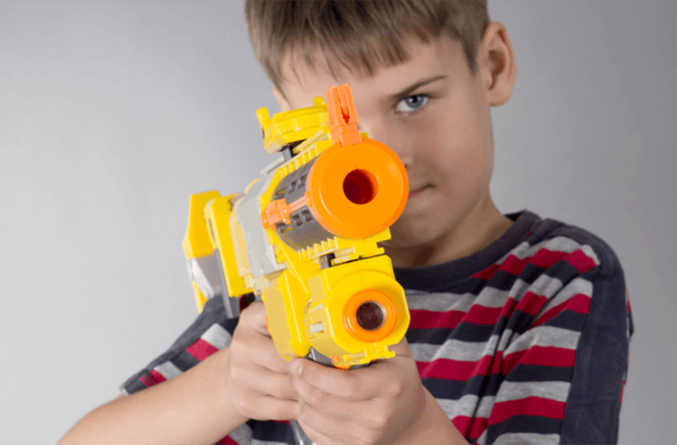boy with toy dart gun not safe for the eyes