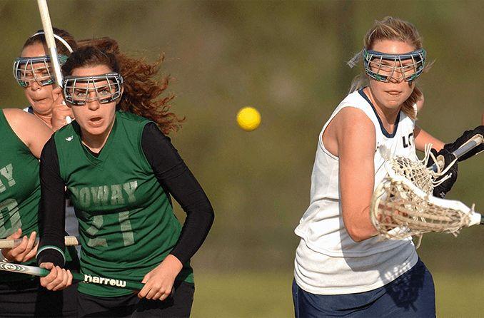 girls playing lacrosse wearing protective eyewear