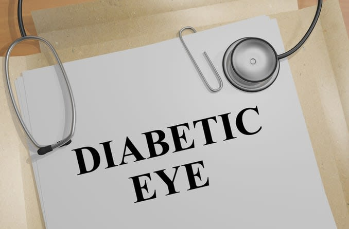 """Diabetic eye"" is written on a sheet of paper with a stethoscope lying on top."