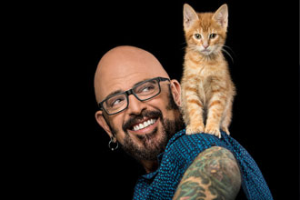 Jackson Galaxy with cat on shoulder