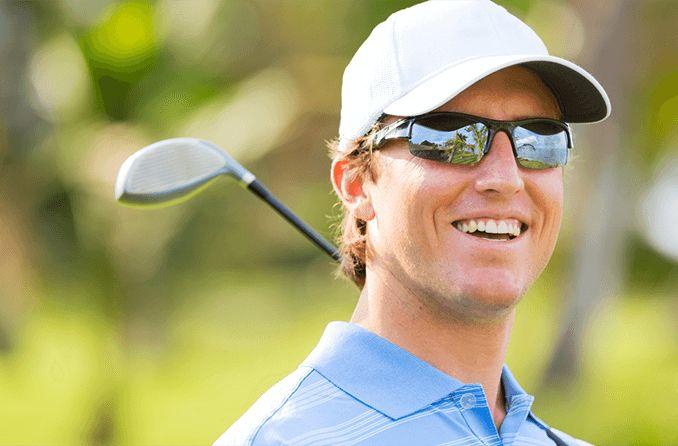 Golfer wearing performance sunglasses