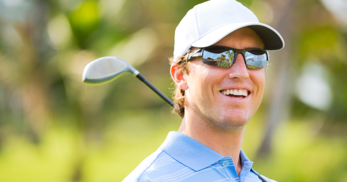 Golfer wearing performance sunglasses