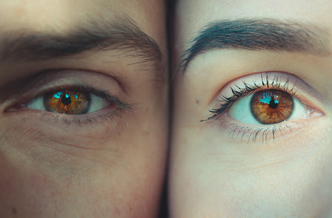 closeup of man and woman eyes
