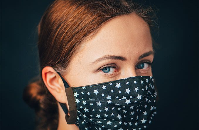 woman wearing a home made face mask to protect from coronavirus