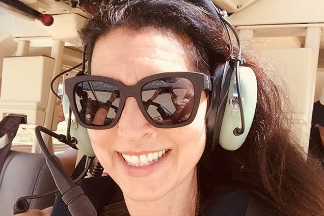 Erica Sandberg wearing sunglasses on a plane