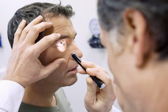Man receiving eye exam due to diabetic-related vision loss