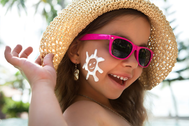 Girl in pink sunglasses and hat