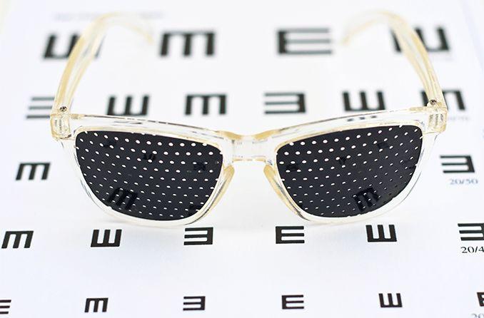 pinhole glasses on an eye chart