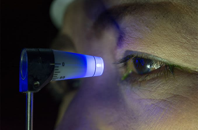 Close up of a glaucoma eye exam testing for eye pressure with a tonometer.