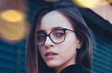 Young woman with long hair and eyeglasses