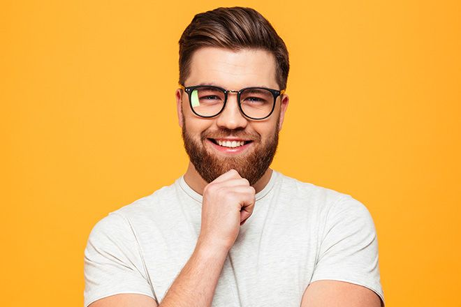 Man wearing oval shaped glasses