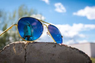 Blue-tinted Aviator sunglasses.