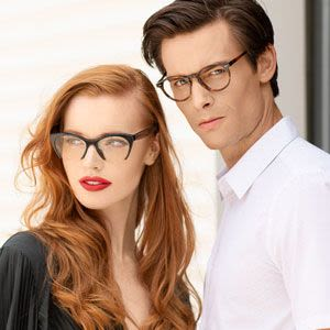 Man and woman wearing trendy eyeglasses