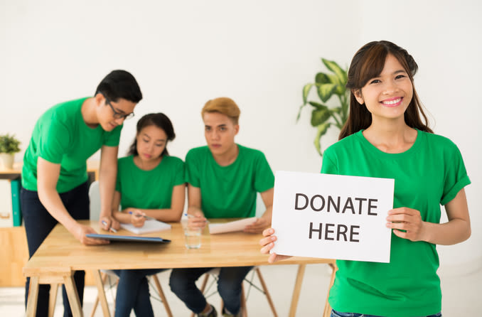 young Asian volunteers collecting donations