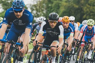 Group of cyclists wearing various sunglasses
