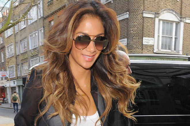 Nicole Scherzinger wearing Carrera 80 sunglasses