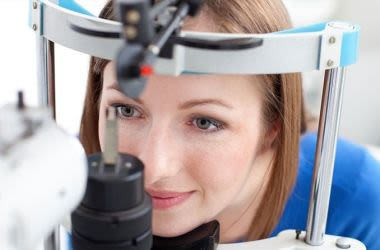 Woman having a glaucoma test eye exam