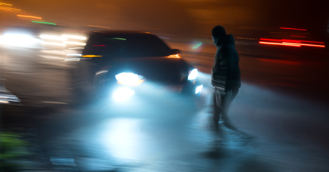 depiction of blurry dangerous driving at night