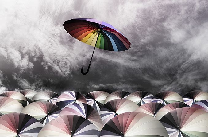 rainbow umbrella fly out the mass of umbrellas viewed from a person who is colorblind