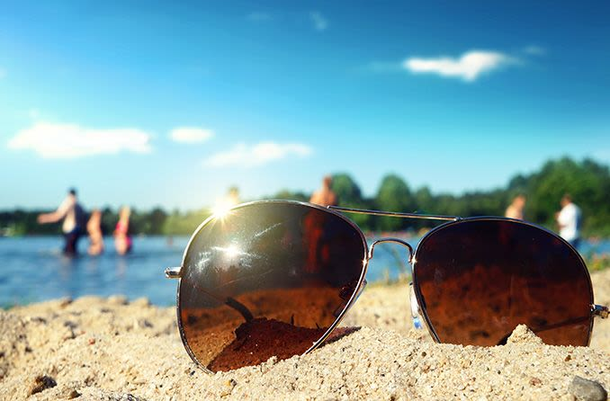 Sunglasses with uv protection lying in the sand