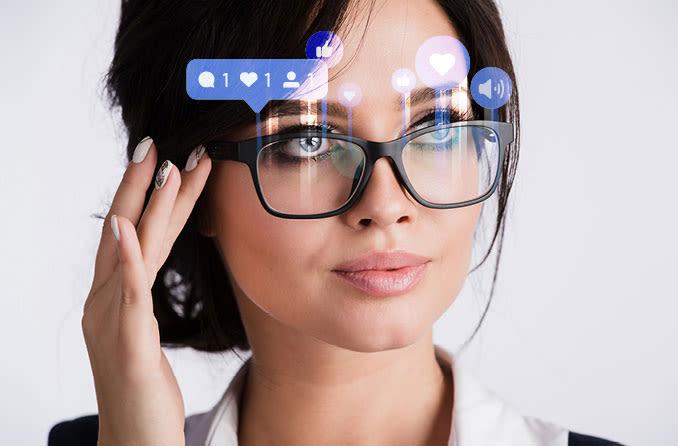 woman wearing new Facebook x RayBan smart glasses
