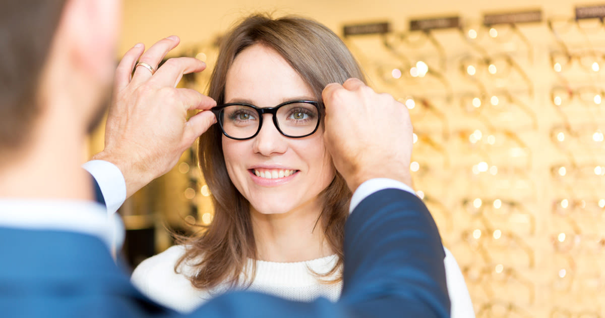 woman being fitted with eyeglasses