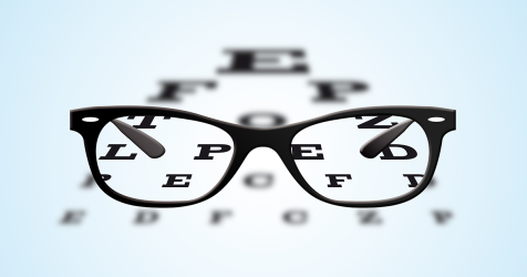 black framed glasses and an eye chart
