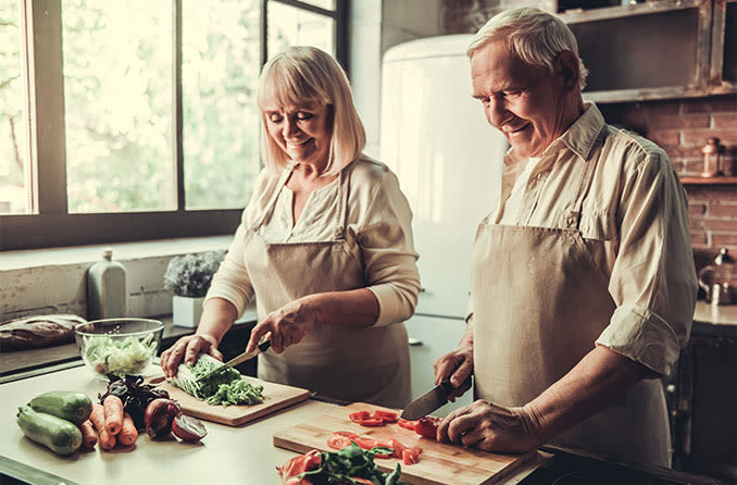 older couple making a healthy meal in order to help prevent cataracts