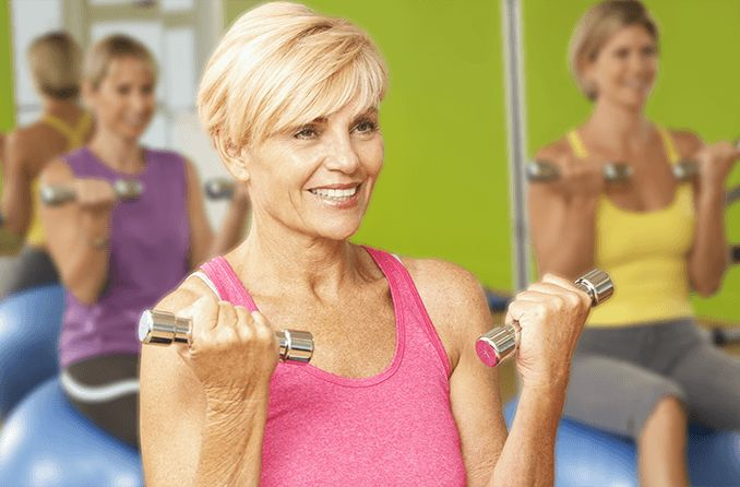 middle-age woman exercising without glasses
