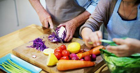 elderly couple making salad