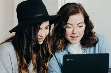 Two girls shopping for glasses online