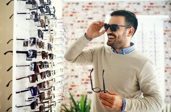 man shopping for sunglasses