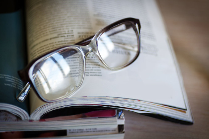 Pair of eyeglasses on top of a book