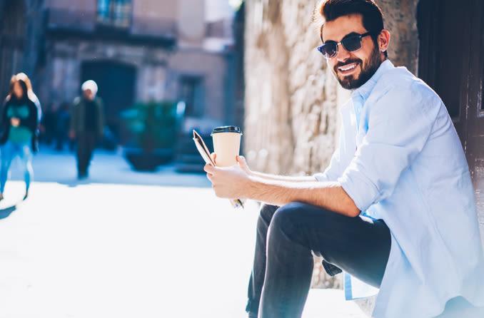 man in sunglasses drinking coffee