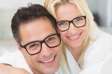 Couple wearing similar eyeglass frames