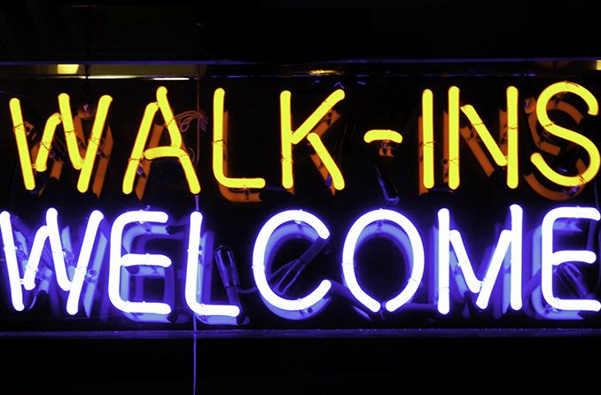 walk-ins welcome neon sign