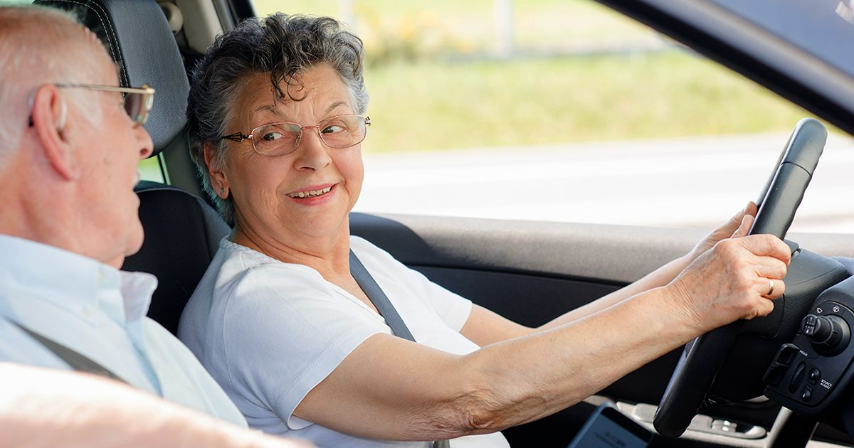 woman over 60 driving car