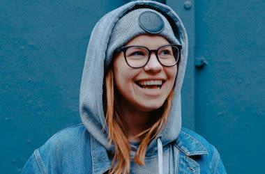 laughing girl wearing eyeglasses