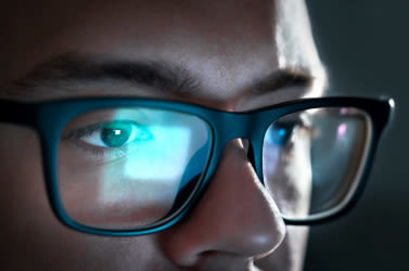 Man wearing blue light computer glasses