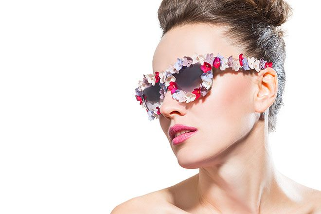 Woman wearing floral sunglasses
