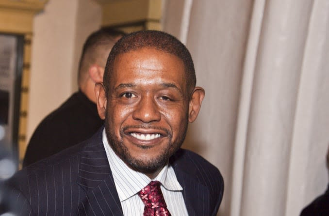 Forest Whitaker smiles for the camera at a film festival