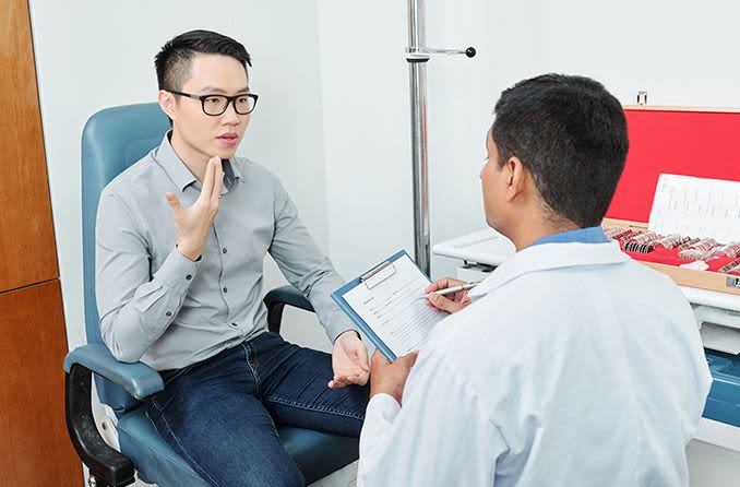 man consulting with eye doctor about lasik age