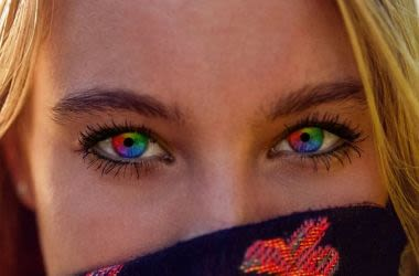 Blonde woman with rainbow colored eyes