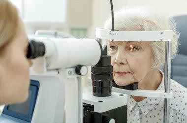 Elderly woman getting annual eye exam