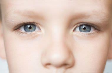 Close up of boys blue eyes