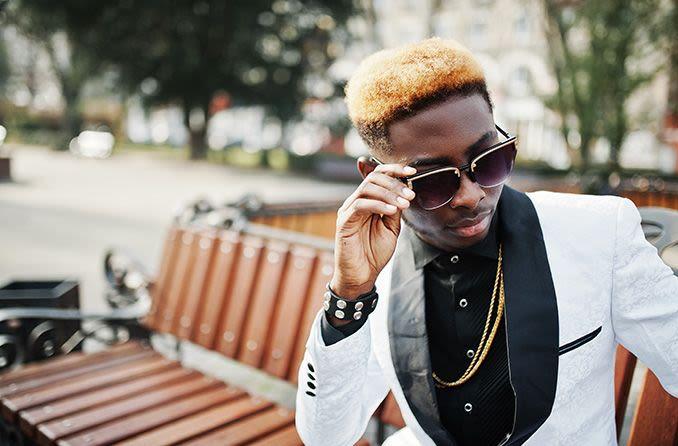 African American male wearing designer sunglasses