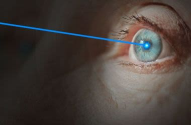 Elderly woman receiving laser eye surgery for cataracts