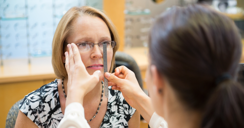 Woman getting fitted for eyeglasses