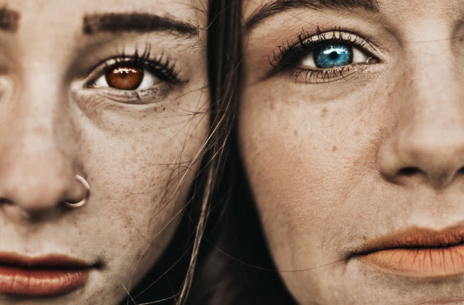 two woman with different colored eyes