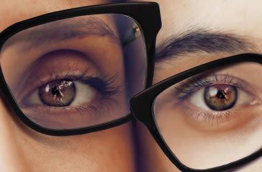Man and woman wearing same eyeglasses